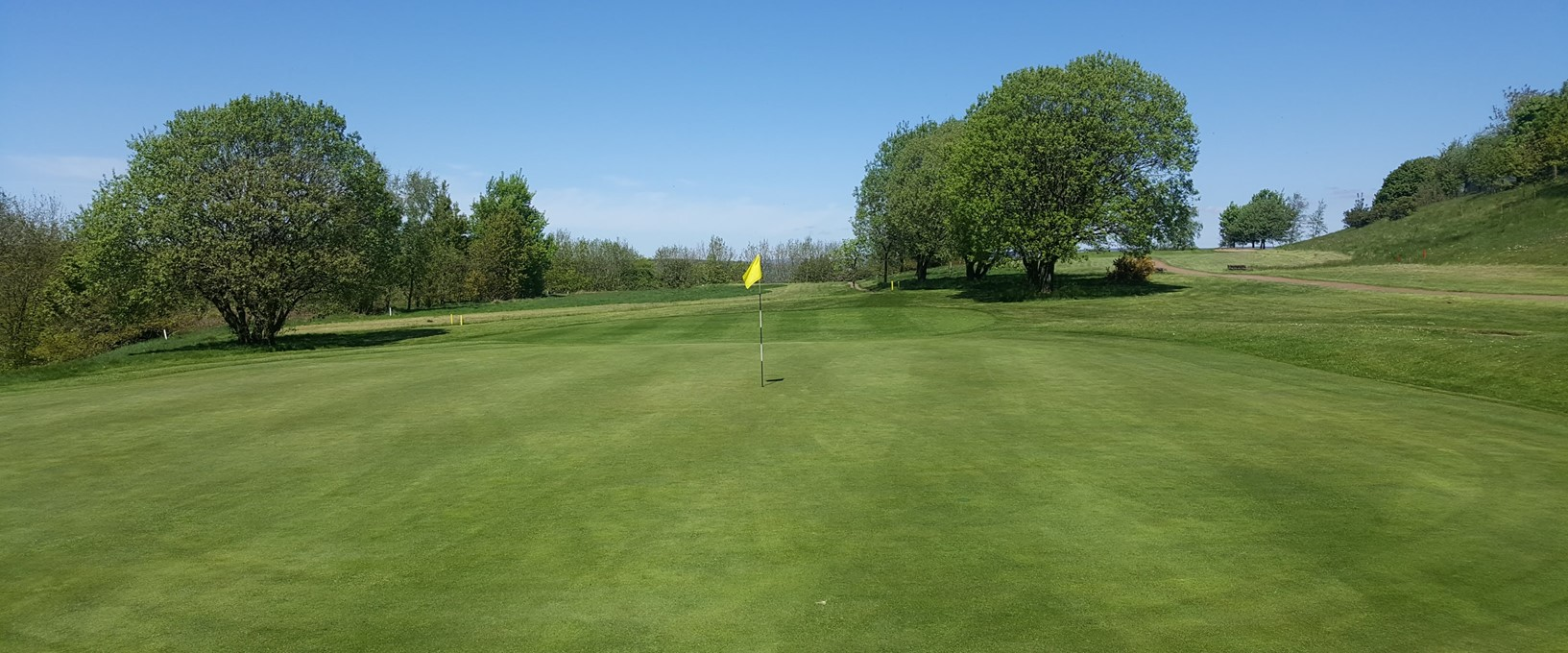 A view from behind the 5th green, one of the Hawtree designed holes, at West Bradford